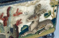 detail of stumpwork deer, looks like little coral beads there too.