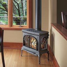 The Tree of Life™ cast iron gas stove by Avalon has a beautiful three-sided fire-view that is inspired by the natural arches of interlocking trees and branches. Available at Rich's for the Home http://richshome.com/