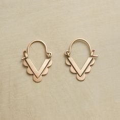 "TRIBAL MUSE EARRINGS -- Inspired by tribal jewelry, Jane Diaz handcrafted these 10kt rose gold earrings, balancing bold shapes with dainty proportion. 3/4""L."