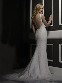 BEAUTIFUL Deep v-neck heirloom lace mermaid gown with low back. Gown is unworn. The Scallop lace at bottom has not been cut. The dress was not shortened. It has been professionally altered. The bust, waist and hips were taken in.