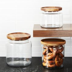 Shop Montana Acacia and Glass Jars.  A beautiful acacia wood lid adds natural warmth to the classic glass canister for storage and display.  Tight silicone seal keeps contents fresh.