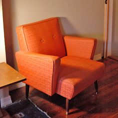Mid-Century Modern Chair Orange. Almost the same chair in USA as the pair retrodad has in green in Australia. Style influences get picked up across the globe!