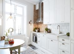 Not this exact look but just to show subway tile I white kitchen with brick wall.