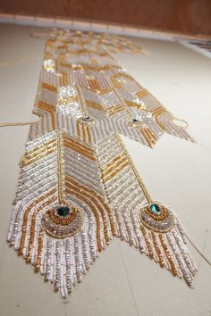 Look under free advanced articles: Make your own Goldwork Peacock Feather (as on vintage House of Worth beaded dress) Tambour Beading, Tambour Embroidery, Couture Embroidery, Gold Embroidery, Embroidery Stitches, Embroidery Patterns, Beading Tutorials, Beading Patterns, Bordados Tambour