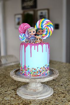 Adorable Lollipop Cake with Cute Dolls LOL Surprise Doll Birthday Cake Doll Birthday Cake, Funny Birthday Cakes, Birthday Cakes For Kids, 7th Birthday Party Ideas, Surprise Cake, Surprise Birthday, 4th Birthday, Surprise Ideas, Lol Doll Cake