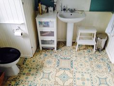 If you like Morrocan style tiles, this vinyl is a budget way to get the look. This piece cost under £50 from Best 4 Flooring http://www.best4flooring.co.uk/loft-cushion-vinyl-flooring-sheet-shalimar-584