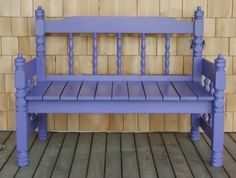 Garden bench made from an old single bed head board (the back of the bench) and foot board (the arms of the bench).  So cute!!