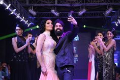 AD Singh Couture Show at Blenders Pride Punjab International Fashion Week. Koena Mitra indulges in a selfie with AD SINGH on ramp. #bollywood #indian wear #indiangowns #gowns #adsingh