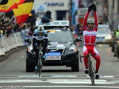Top marks for victory salute form; Italian veteran Luca Paolini (Team Katusha) beat his breakaway companion Stijn Vandenbergh (Omega Pharma - Quick-Step Cycling Team) in the two man sprint to the line to win the 2013 Omloop Het Nieuwsblad    From steephill.tv - Omloop Het Nieuwsblad (2013) Photos