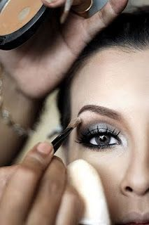 She does a Kim Kardashian smokey eye look that is awesome.