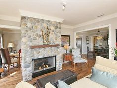 do this in great room to break it up?  San Diego house rental - Living room with 2 sided cobblestone fireplace.