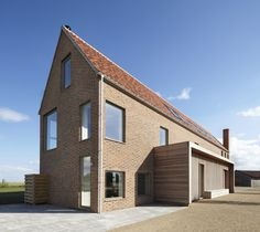 House in England designed by Lucy Marston to reference old English farmhouses. It features red brickwork, a steep gable and a corner chimney. Farmhouse Architecture, Brick Architecture, Beautiful Architecture, Residential Architecture, English Farmhouse, Rural House, English House, Small Buildings, Brickwork