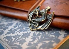 Bronze dragon pendant , metal dragon keychain, brass dragon trinket skyrim dragon, game of thrones, Daenerys necklace, Dragon Jewelry