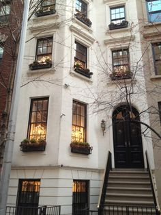 upper east side brownstones | an elegant upper east side brownstone with wreaths in each window ...