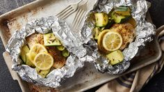 These quick and easy lemon chicken foil packs paired with zucchini, squash and thyme are a perfect summertime dinner.