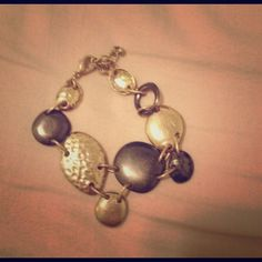 NWOT Cute Bracelet!! Cute gold and grey bracelet with an adjustable wrist clasp. Never worn, just no tags! Jewelry Bracelets