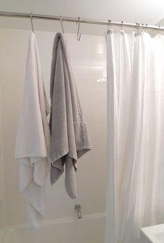 space-saving bathroom towel hook solution: pot hooks