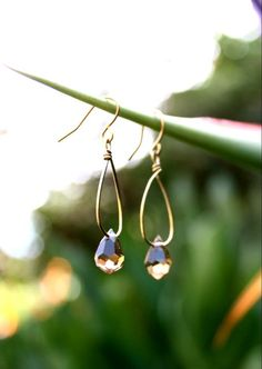 #E0030    As simple as they come! A single auburn brown tear-drop shaped Swarovski crystal hangs from gold-filled wire.    **CUSTOMIZABLE  **Matching necklace and bracelet available