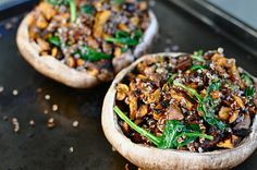 My favorite new gluten-free vegetarian dinner. Portobello mushrooms stuffed with roasted sweet potatoes, spinach, and quinoa