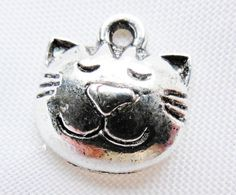 Hey, I found this really awesome Etsy listing at http://www.etsy.com/listing/120769359/25-tibetan-silver-cat-face-charms