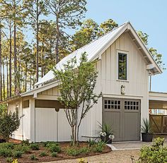 Exterior: The Garage - Palmetto Bluff Idea House Photo Tour - Southern Living >> nice color, nice garage doors Exterior House Colors, Interior Exterior, Exterior Paint, Exterior Design, Modern Farmhouse Exterior, Farmhouse Style, American Farmhouse, Cottage Exterior, White Farmhouse