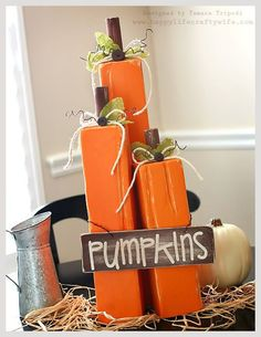 Fall pumpkin decoration DIY! Create these cute wooden pumpkins with a 4x4! Tutorial included! www.happylifecraftywife.com