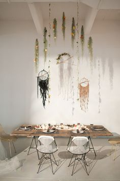 Dreamcatchers and florals hanging from the ceiling. love.