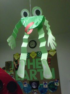 Here's a frog that incorporates the painting and hand prints and footprints from some one year old KinderCare students.