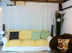 fabric covered walls in basement | Unfinished Basement given a fabric and paint finish with drapes ...
