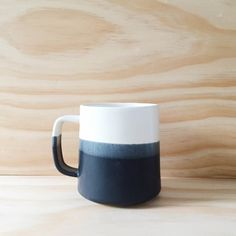 This listing is for one Danish inspired handmade coffee mug in Black + White. The size of these mugs ranges slightly, but generally holds 12oz. All of my work is food safe, and can be microwaved.   Paper & Clay is a small shop making small batches of handmade ceramics. My quantities are limited as I make each piece from start to finish with these two tiny hands. I thank you so much for your patience concerning availability, and for your support of my work. SHIPPING:  All in-stock orders will…