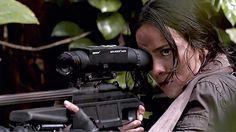 Isabelle (Alice Braga) aims her Blaser R93 LRS2 Sniper rifle with Elcan DigitalHunter scope.