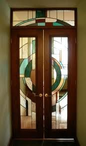 This Art Deco entryway is one of a series of art glass door panels in this contemporary styled high-rise Chicago condominium. The curved lines, geometric shapes and contrasting glass colour & texture help to identify this as an art deco piece. Arte Art Deco, Moda Art Deco, Cool Doors, Unique Doors, Portal, Art Nouveau Arquitectura, Architecture Art Nouveau, House Architecture, Art Deco Door