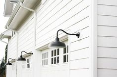 ... white modern farmhouse. And last but certainly not least, are the black gooseneck barnlights on our garage. Barnlights like this are becoming easier and ...