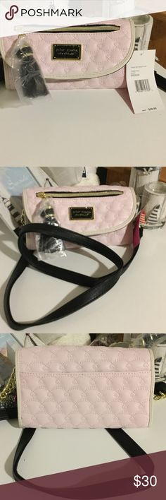 Betsey Johnson front zip pocket flap Light pink pocket flap. Tassel pull zipper. Black and gold name plate. Black shoulder strap with gold links. Brand new Betsey Johnson Bags Mini Bags