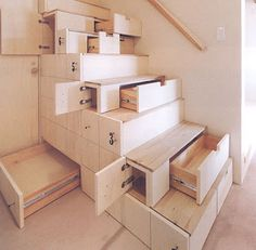 stairs with tons of hidden compartments & storage!!! {...you know i love me some organizers!!!}