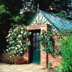 VICTORIAN GREENHOUSE DOOR SURROUNDED BY ROSE 'PENELOPE' PASHLEY MANOR, SUSSEX