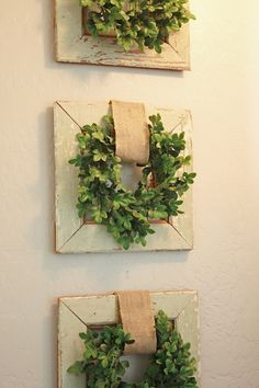 """Boxwood wreaths on top of frames with burlap """"hangers."""""""