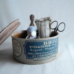 Vintage sewing kit with scissors, lace, lace bobbin, buttons, tin box, pincushion, thimbleFrom lapomme