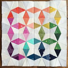 What a stunning paper-pieced mini-quilt by Sarah Cruickshank (@sairzey)!