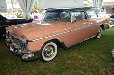 54 pink chevy wagon, white roof