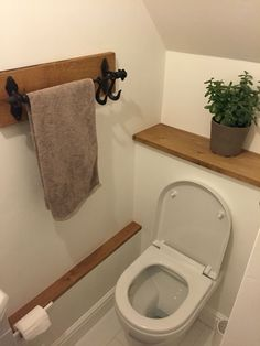 Downstairs WC cloakroom with concealed cistern and oak shelf under ...