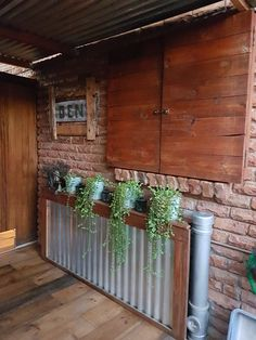 DIY shutters, rustic name board, clever way to hide unsightly drains and pipes Garden Gates, Balcony Garden, Hiding Pipes, Drain Pipes, Diy Shutters, Farmhouse Laundry Room, Drain Cover, Outdoor Rooms, Fencing