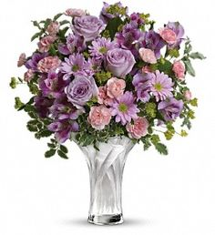 Simply exquisite. This stunning arrangment of purple and pink blooms is beautifully presented in a Celebrate Mom glass vase.    Lavender roses, purple alstroemeria, light pink miniature carnations and lavender daisy spray chrysanthemums are accented with assorted greenery. Delivered in a Celebrate Mom vase.