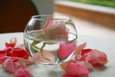 Flower in water bowl (possible idea for outside tables during cocktail hour) - maybe use a white rose?