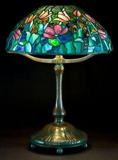 A TIFFANY STUDIOS PATINATED BRONZE LAMP WITH TULIP GLASS SHADE . Tiffany Studios, Corona, New York, circa 1900