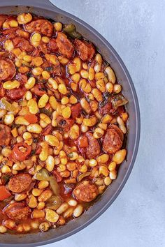 This Spanish white bean stew is a great way to eat your beans! The chorizo makes… This Spanish white bean stew is a great way to eat your beans! The chorizo makes it extra warm and cozy, perfect for a weeknight dinner. Spanish Beans, Spanish Dishes, Spanish Cuisine, Spanish Stew, Spanish Sausage, Spanish Chorizo Recipes, Spanish White Beans Recipe, White Bean Recipes, Spanish Food Recipes