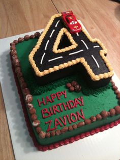 Cars birthday cake - but with matchbox car