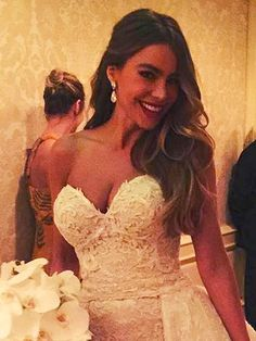 "Sofia Vergara & Joe Manganiello's Super-Glam Wedding Album | LADY IN WHITE | Hello, gorgeous! ""I want to look sexy. I want to look great,"" Vergara previously said of her dream wedding dress. ""I want to look good and [wear] something that I know is going to look good in pictures."" And she definitely nailed it. Vergara complemented her strapless silk-tulle dress (and detachable skirt!) with Lorraine Schwartz diamond earrings and an orchid bouquet."