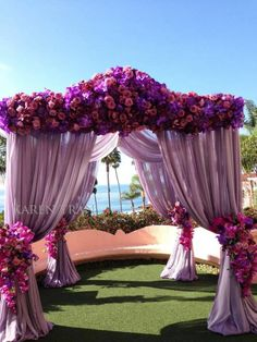 Abundance of flowers combined with gorgeous fabric in shade of purple #wedding #cermony #puple