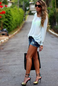 Gorgeous white stylish plan blouse with denim blue stylish jeans short skirt and black leather plan hand bag and golden style high heels ladies sandals the best summer street style & fabulous fashion outfits
